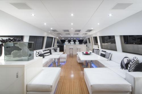 106 Leopard Yacht Charter Salon Seating Night