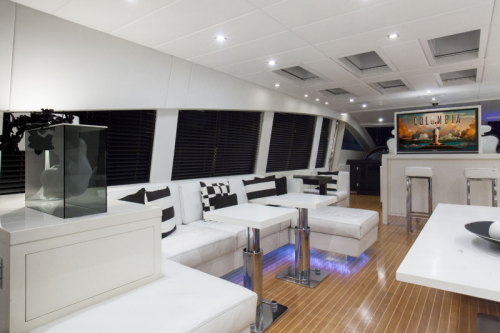 106 Leopard Yacht Charter Salon Seating Port Side