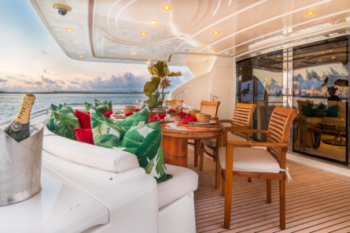 94 Ferretti Miami Yacht Charter Aft Seating and Table